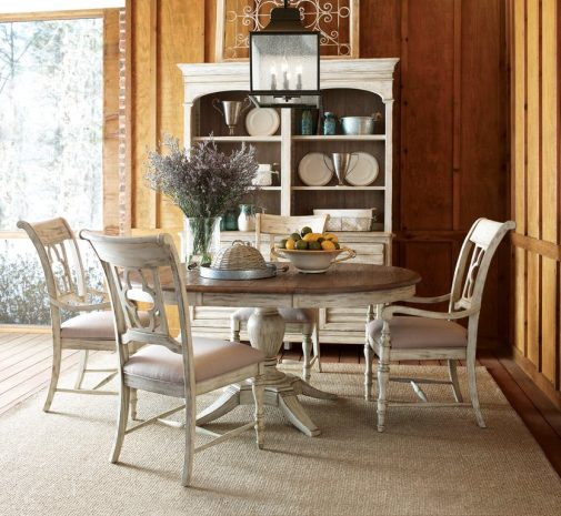 Farmhouse Style Round Dining Table with Decorated Hutch