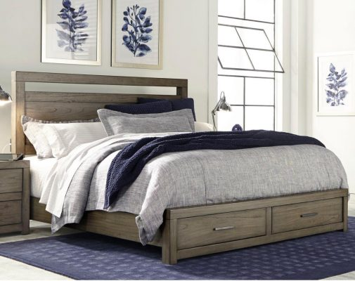 Made Bed with Drawers on Blue Bedroom Rug