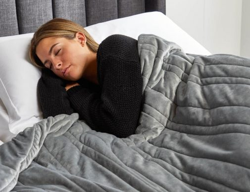 Woman Sleeping with Weighted Blanket
